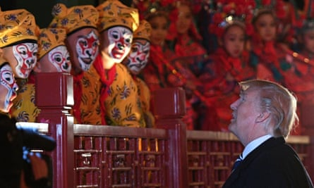 Donald Trump talks to opera performers at the Forbidden City in Beijing as his state visit began amid great pomp and circumstance.