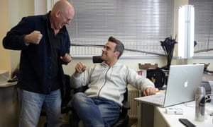 David Enthoven with Robbie Williams in 2009. 'Without David I might have died,' Williams said.