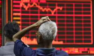 An investor follows the turbulent stock market in China.