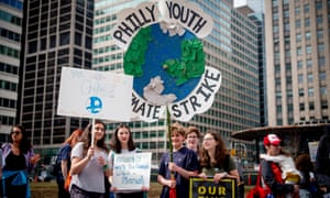 Scores of young people, including students staging a walkout, attend the Philly Youth Climate Strike in Love Park in solidarity with dozens of marches around the world, March 15, 2019. Their concerns include unchecked pollution and other environmental risks they feel are not being addressed by adults in government.