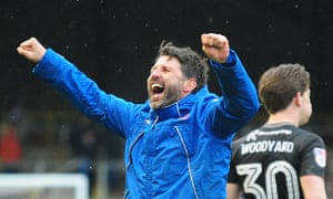 Danny Cowley celebrates Lincoln City's 1-0 win at Carlisle United on Easter Monday, with midfielder Alex Woodyard behind him