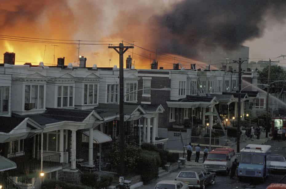 A May 1985 photo shows row houses burning in a fire in the West Philadelphia neighborhood after police dropped a bomb on the Move home.