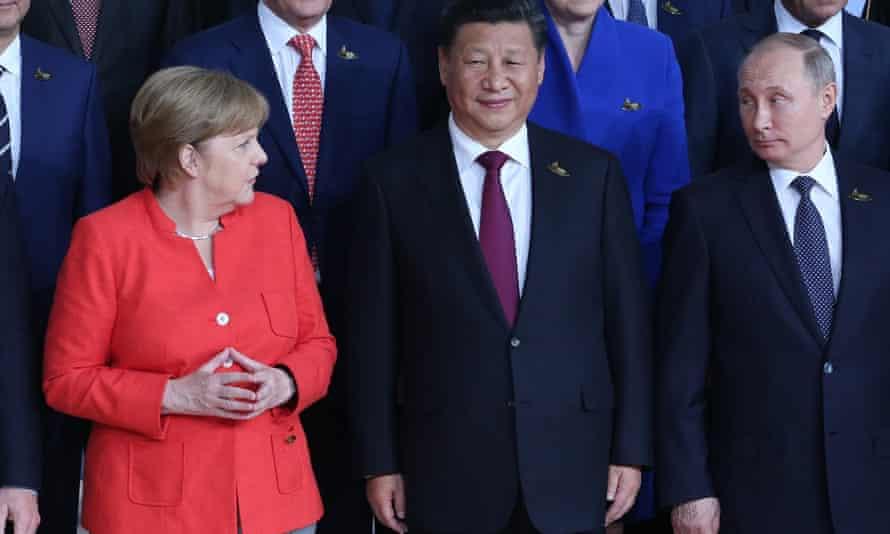 Merkel with Xi Jinping and Vladimir Putin at the G20 in Hamburg in 2017.