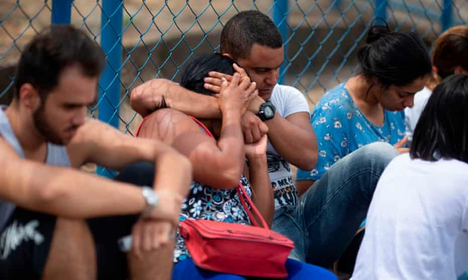 People wait for information about their relatives 26 January 2019 a day after the collapse of a dam at an iron-ore mine belonging to Brazil's giant mining company Vale.