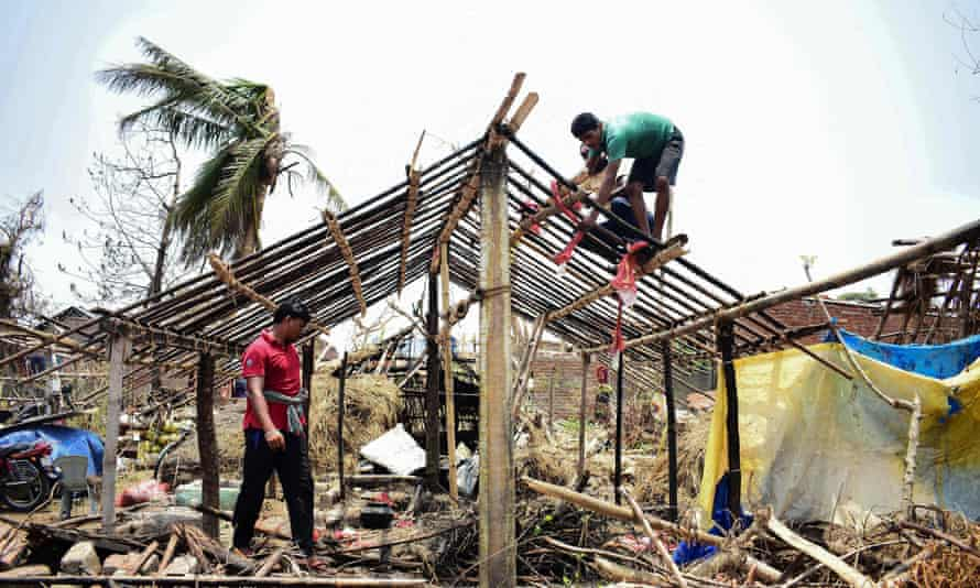 Indian residents rebuild houses after they got destroyed by the cyclone 'Fani' in Puri in the eastern Indian state of Odisha on 12 May 2019.