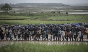 Rohingya Muslim refugees wait for food at a camp in Bangladesh.