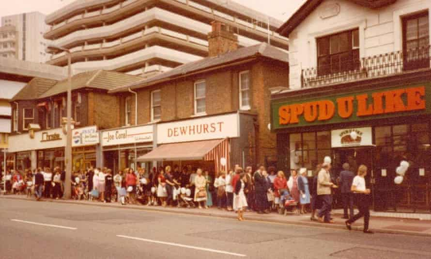People queue to enter a Spudulike shop