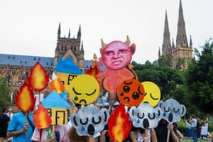 Protesters hold up placards as activists rally for climate action in Hyde Park on Friday