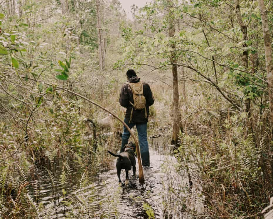 Pompi Rodriguez goes hunting for feral hogs with his trained hunting dogs.