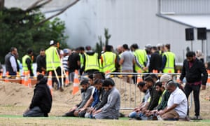 Mourners pray during the burial of Haji Mohammed Daoud Nabi.