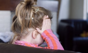 A girl holding the side of her head