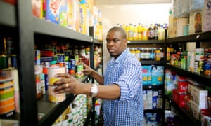 A Croydon food bank helper works in the store cupboard.
