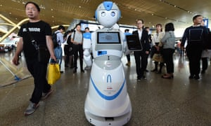 A robot designed to answer passengers' questions at Changshui International Airport, China.