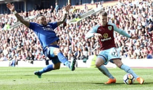 Burnley's Johann Gudmundsson crosses despite the onrushing Leicester City's Danny Simpson as Burnley see out a 2-1 win at Turf Moor.