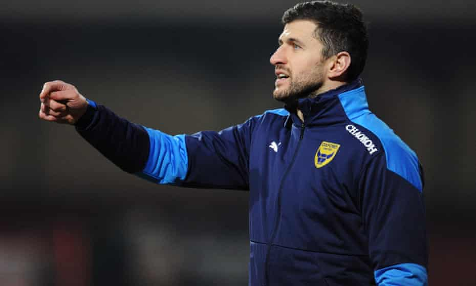 John Mousinho gives his team instructions from the touchline as he helps out with the Oxford United backroom staff.
