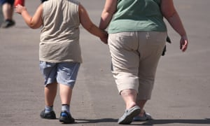 An overweight child and adult