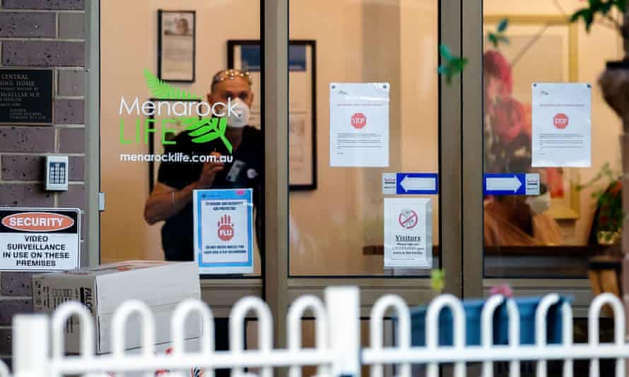 Cleaners in the main reception of the Menarock Life aged care facility in Essendon, which has has bee linked to 55 cases of Covid-19