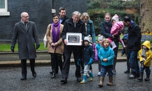 Lord Alf Dubs (C) arrives with council leaders and children to deliver a petition to 10 Downing Street calling on the government to reconsider its decision to end the 'Dubs' scheme.
