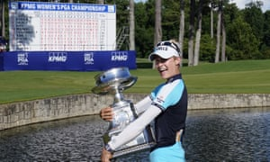 Nelly Korda celebrates with the Women's PGA Championship trophy.