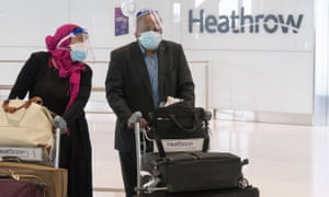 People arrive at Terminal 5 of Heathrow Airport in London on 8 June 2020.