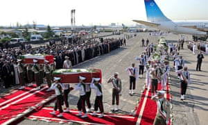 An honour guard carries the coffins of Iranian hajj pilgrims who were killed in the stampede on 24 September.