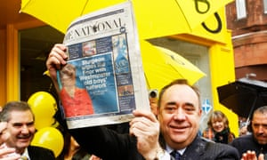 Former SNP leader Alex Salmond holds a copy of The National newspaper during the general election campaign.