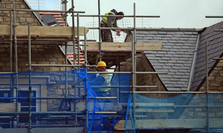 Construction workers build new houses near Bristol, England.
