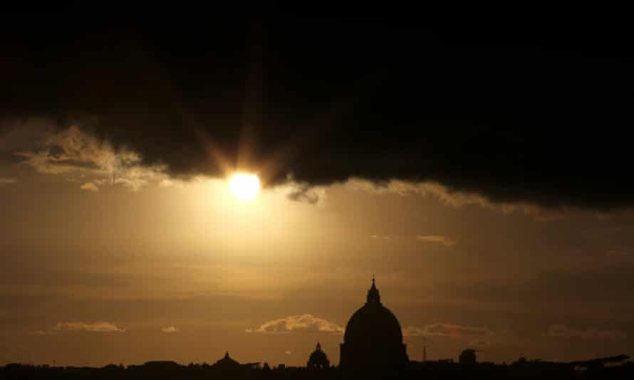 Perfect storm … clouds over St Peter's Basilica in the Vatican. Photograph: AFP/Getty Images