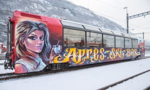 A specially converted and graffitied carriage on the Andermatt-to-Disentis train