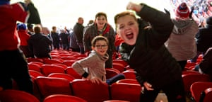 Young Boro fans celebrate after Stewart Downing scored.