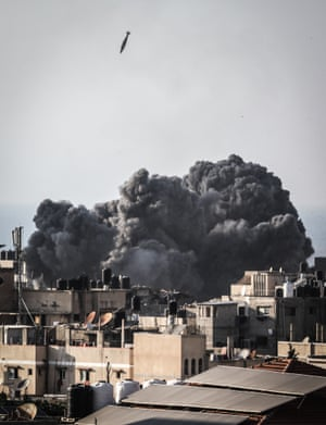 Under fire … bombs fall on Gaza City on 9 August.