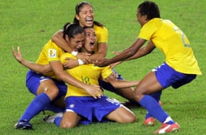 Brazil's Marta, centre, is congratulated by her teammates after she scored against the USA.