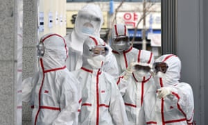Medical staff in protective gear arrive for a shift at Dongsan hospital in Daegu, South Korea.