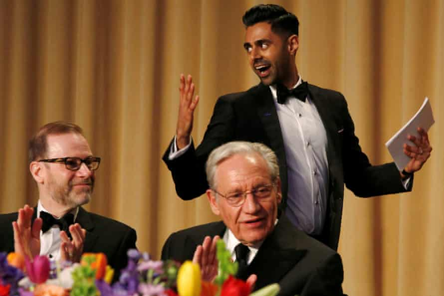 Hasan Minhaj passes Bob Woodward (centre) and Reuters editor-in-chief, Steve Adler at the White House correspondents' dinner.