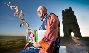 Wes White the Bard of Glastonbury who has an American wife Erica Viloa, pictured on Glastonbury Tor.
