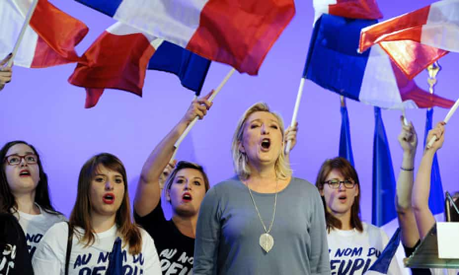 Marine le Pen with young FN supporters.