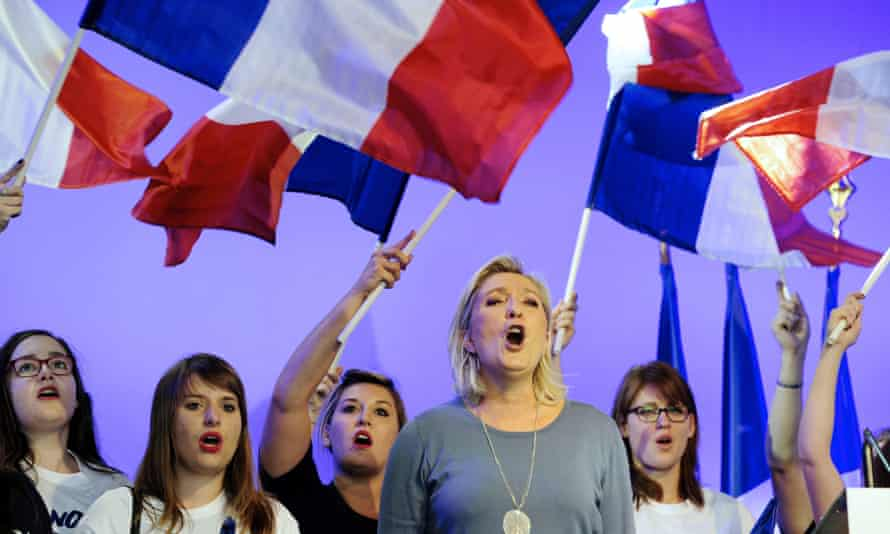 Marine Le Pen sings the French national anthem at the FN conference in Fréjus