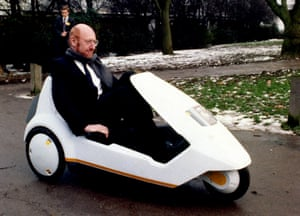 Sir Clive Sinclair demonstrating his C5 electric vehicle.