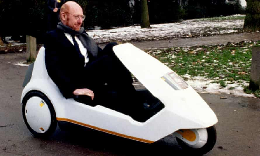 Sir Clive Sinclair demonstrating his C5 battery-pedal-powered trike at Alexandra Palace in London circa 1985.