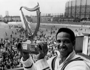 The captain of the Rest of the World, Gary Sobers, with the Guinness Trophy, after his team beat England at the Oval to take the series