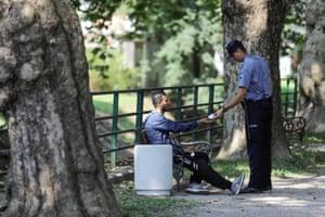 A migrant offers his ID for inspection near Croatia's border in Bihać
