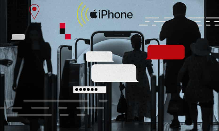 People enter the subway in front of an iPhone 12 advertisement in Shanghai