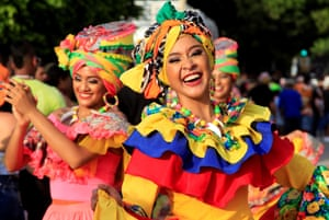 A dance troupe participates in the Cabildo de Getsemaní parade as part of independence celebrations in Cartagena, Colombia