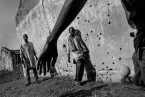 Boys play football outside former school building at Gwoza IDP camp