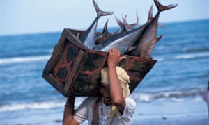 A fisherman in the Philippines with a tuna catch.