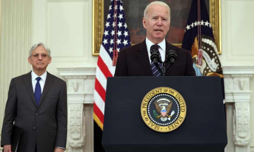 President Joe Biden discusses firearm crime prevention measures as Attorney General Merrick Garland watches.