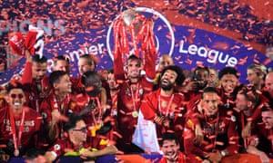 Liverpool captain Jordan Henderson lifts the Premier League trophy.