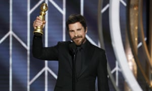 Christian Bale with his Golden Globe for Vice.