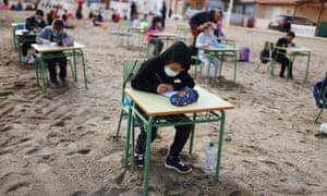 Students of the Felix Rodriguez de la Fuente school study outside at the Playa de los Nietos, near Cartagena, southern Spain.