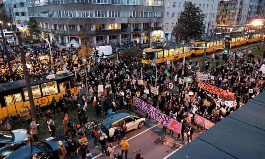 Protesters block a street in Warsaw on Monday